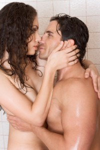 naked Man and woman in love are kissing in shower