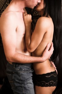 Two hot young lovers embrace