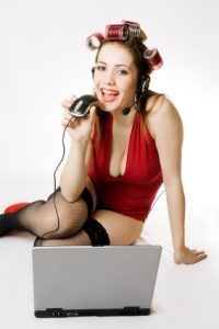Girl in red top over laptop