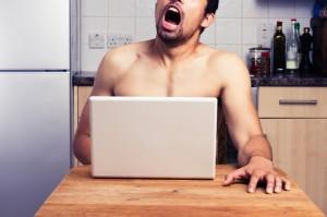 Man sat jerking off over laptop