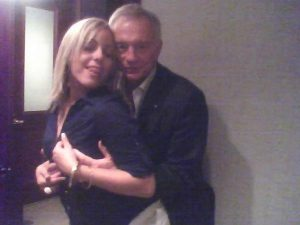 Jones holding blonde woman's boobs from behind