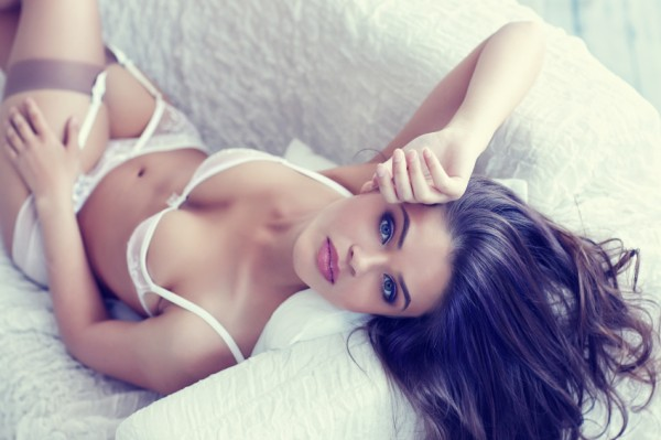 close up portrait of beautiful alluring young woman in white sex