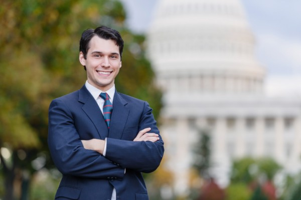 Politician stands in front of Capitol building