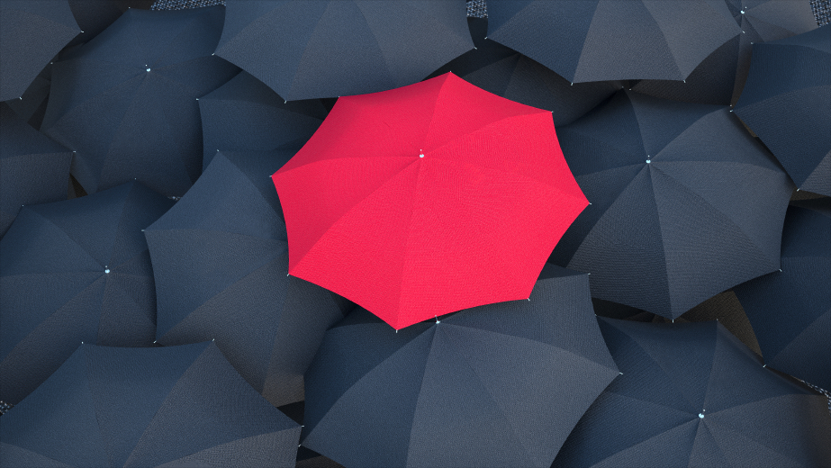 Red umbrella in the crowd