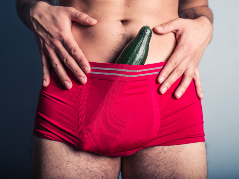 Man with cucumber in his pants