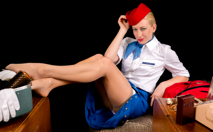 Retro Airline Stewardess or Attendant Posing Provocatively at her Vanity.