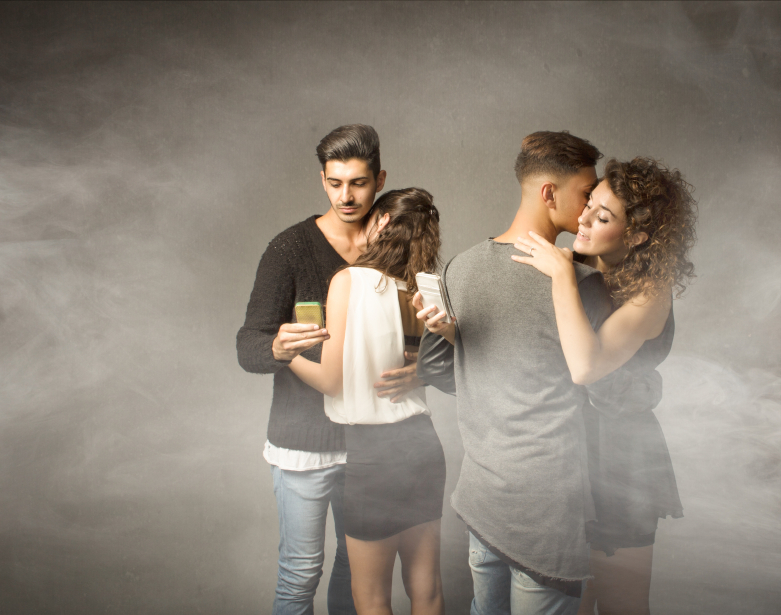 Two couples embrace