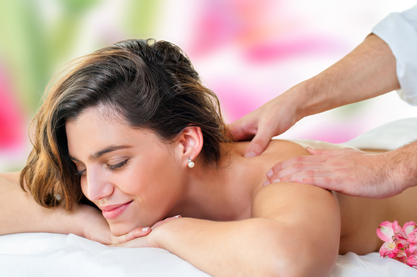 Young woman enjoying back massage.
