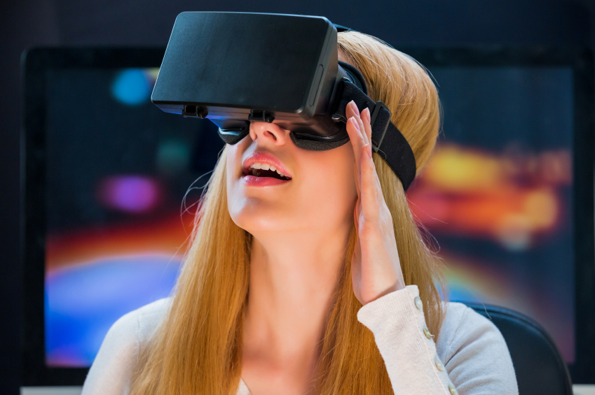 Virtual reality poen being watched by a blonde woman
