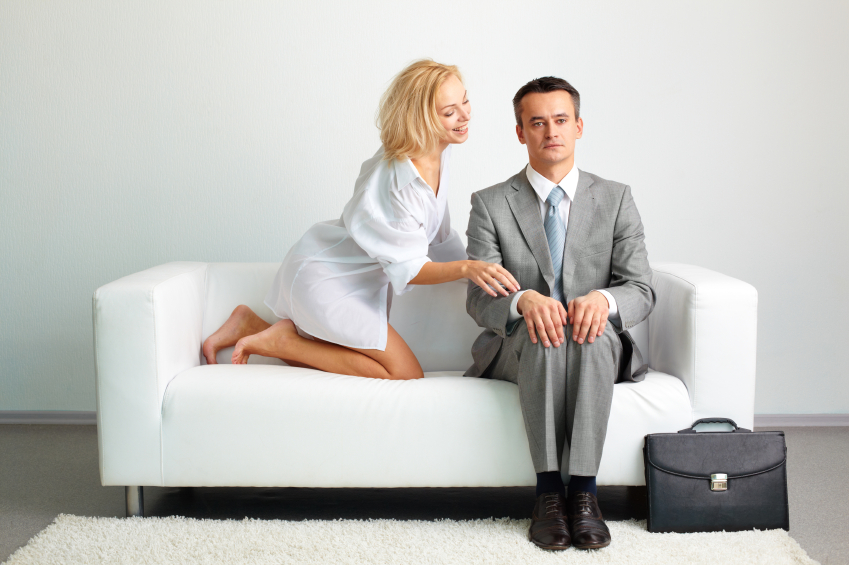A couple sitting on a sofa, trying to deal with the man's penis problems