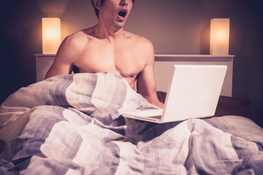 Man masturbating under bed to laptop