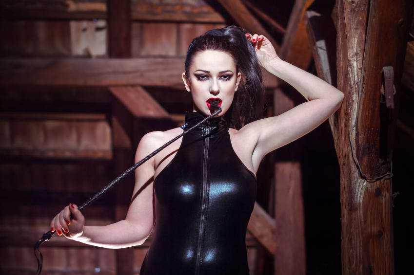 A hot dominatrix stands here ground