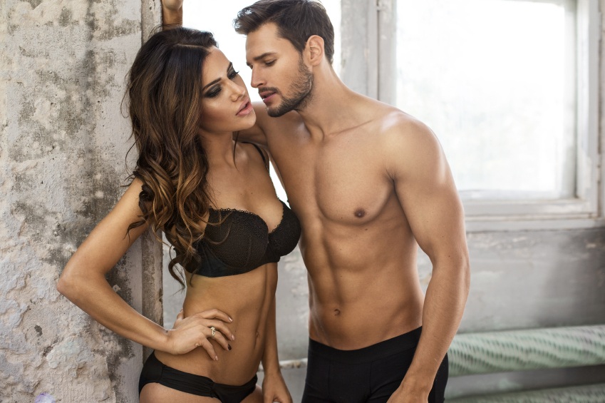 A sexy couple stand in their underwear, eager to learn if the penis or vagina is stronger