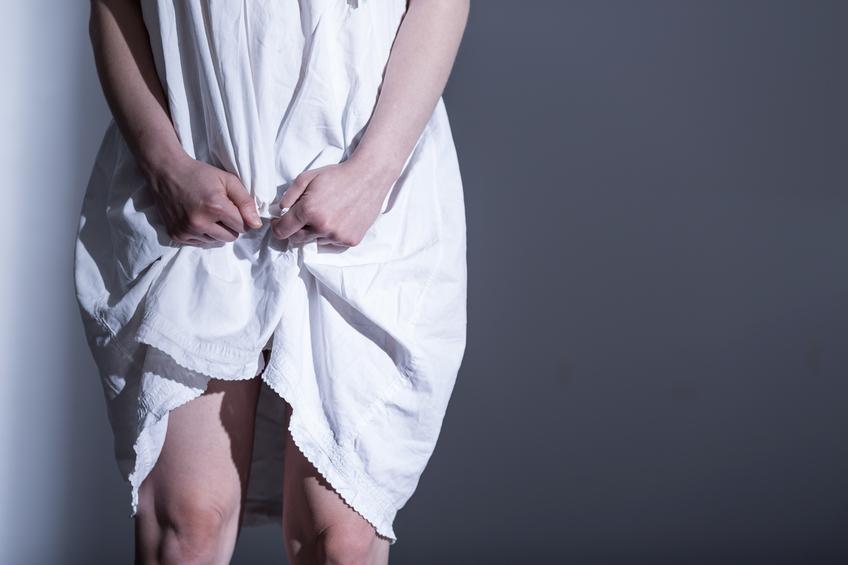 Rape victim in white sheet