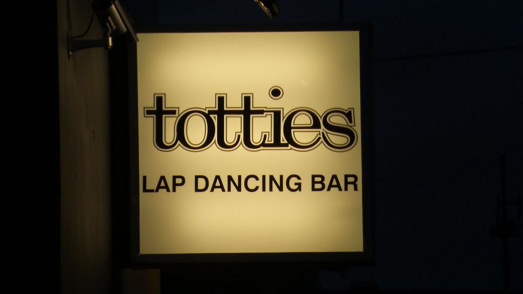 Totties strip club sign