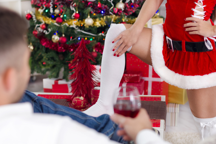 A sexy Mrs Clause seduces her partner at Christmas