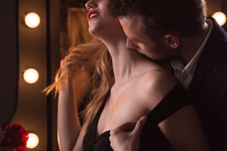 Horizontal picture of mature man kissing beautiful woman's neck