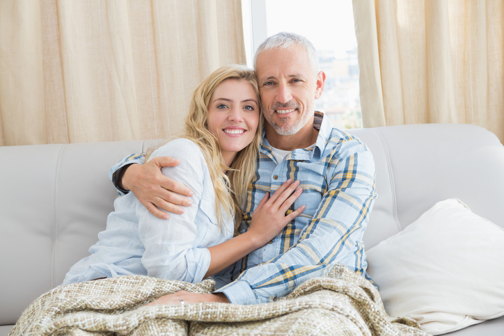 Older man and younger woman on couch