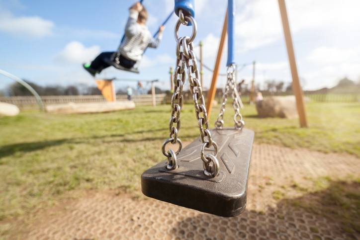 Kid playing on a swing