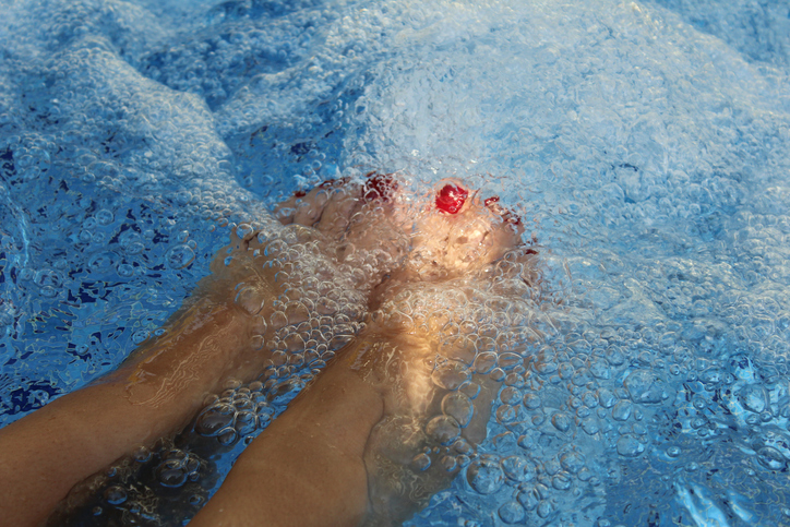 Woman's feet in hot tub