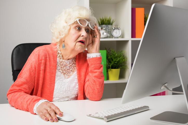 Grandma looking shocked at a computer screen