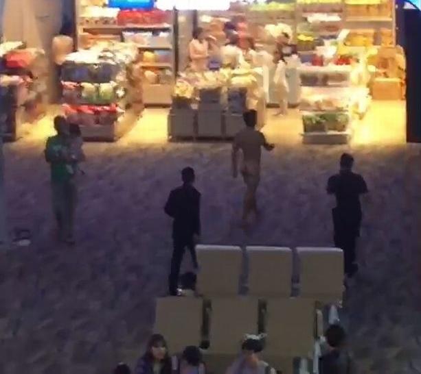 naked man walks around airport