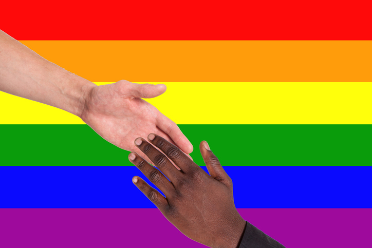 LGBTQ flag with black and white hand