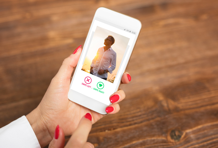 Unrecognizable woman using dating app and swiping user photos