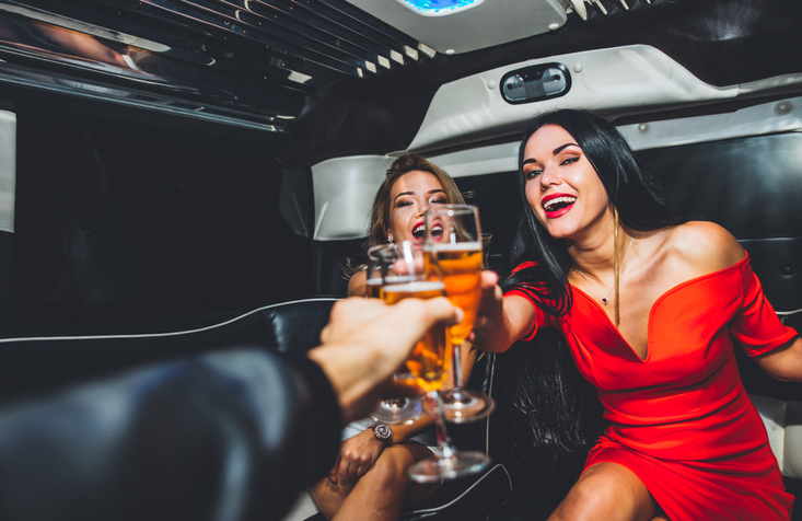 beautiful-girls-with-champagne-making-party-in-limousine